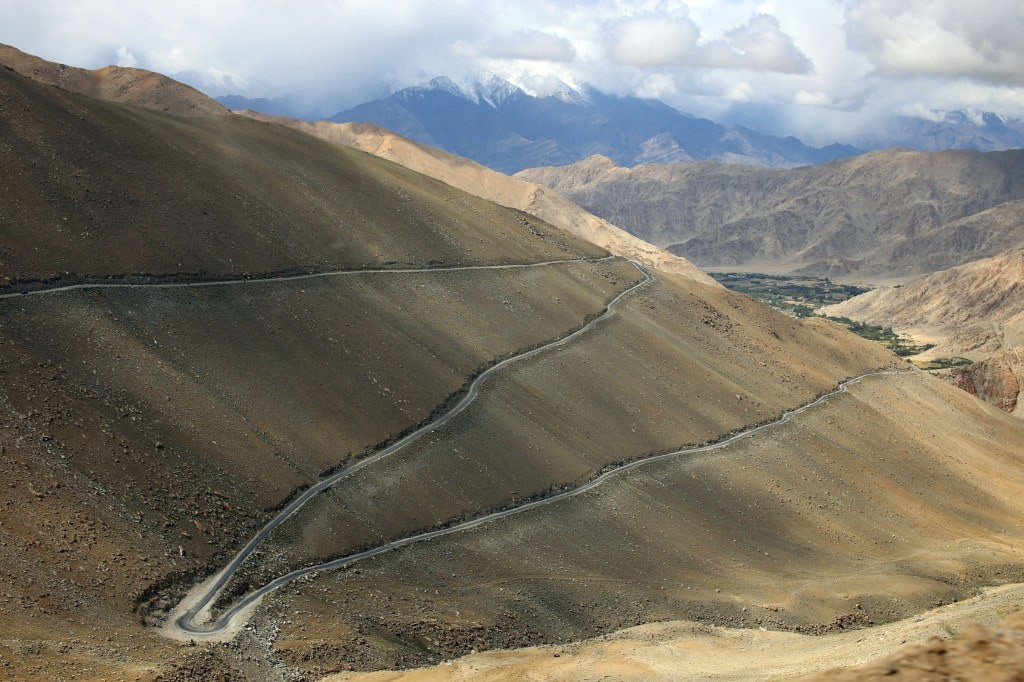 a_winding_mountain_road_in_the_himalayas