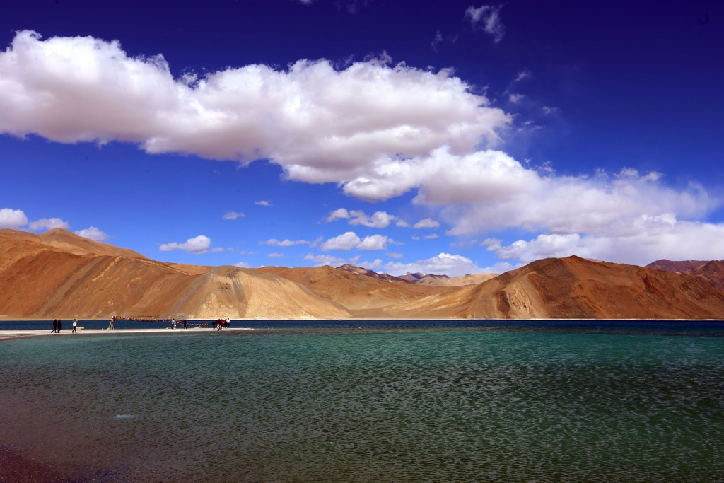 orange_mountains_as_a_contrast_to_blue_water_of_a_mountain_lake_in_himalayas