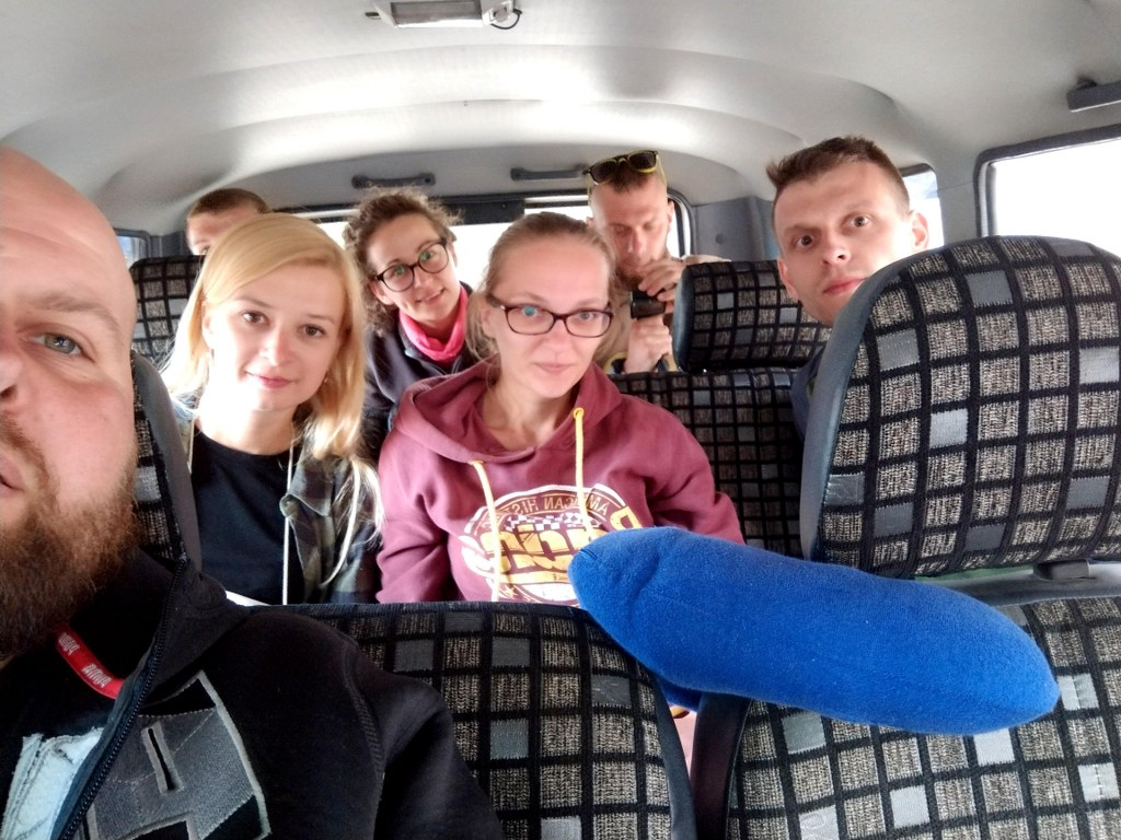a_group_of_seven_friends_inside_a_mini_van_in_the_himalayas