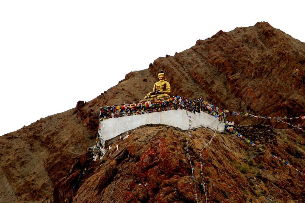 a_huge_golden_buddha_sculpture_on_a_mountain_edge