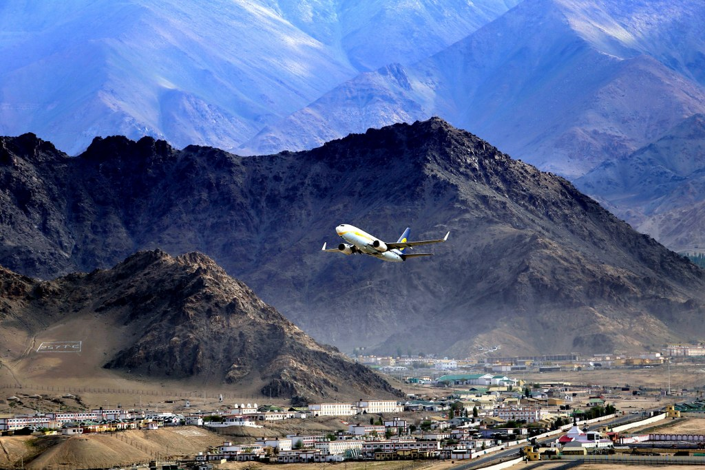 a_plane_taking_off_from_a_mountain_airport_surrounded_by_the_high_himalayas