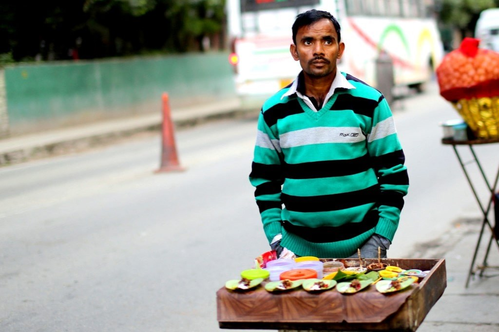 an_indian_men_selling_food_on_a_street