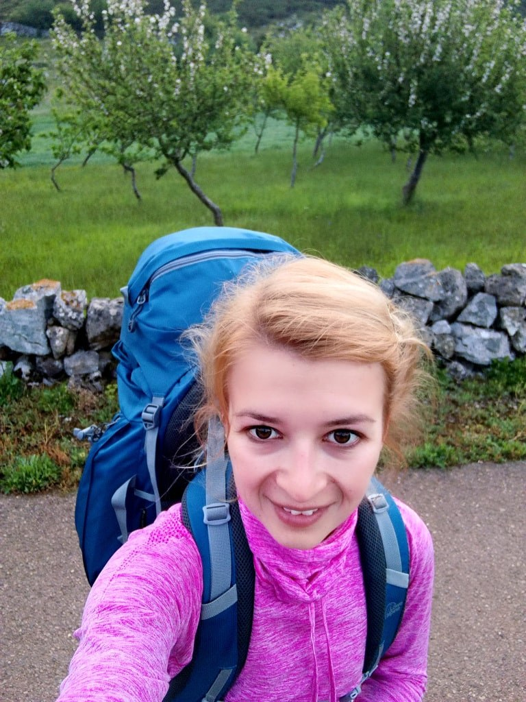 blond_smiling_girl_with_a_huge_backpack
