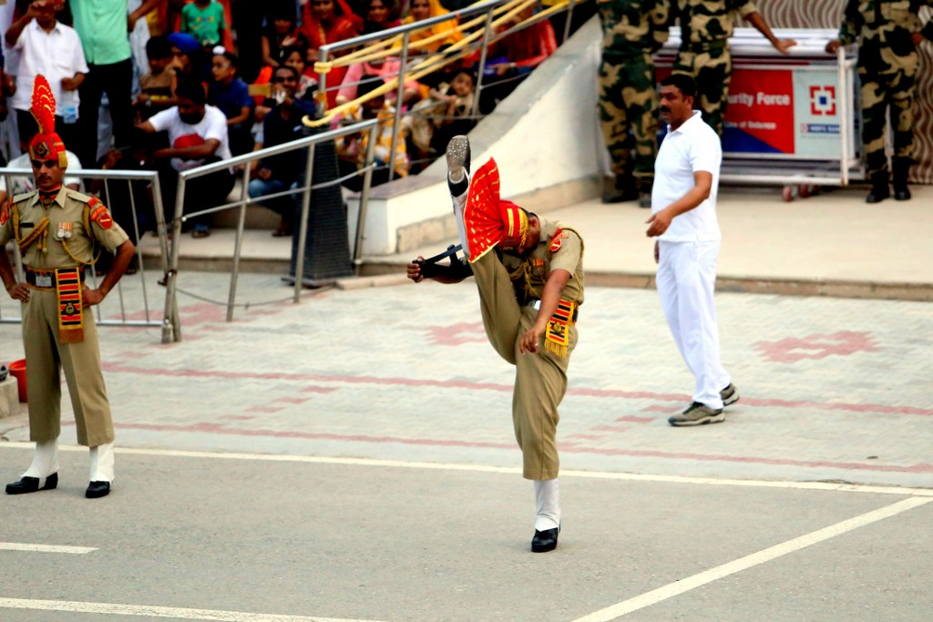 indian_officer_pulling_his_leg_toward_his_head