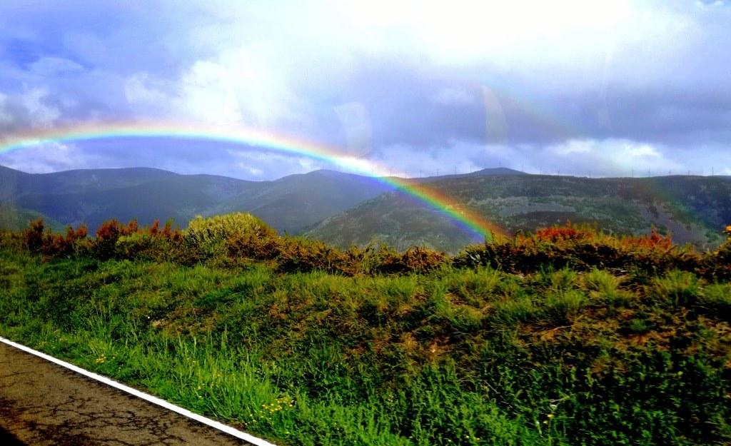 rainbow_over_a_mountain_landscape