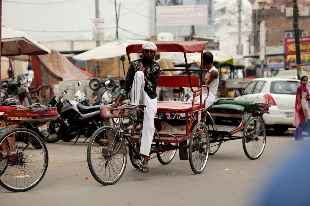 riksha_driver_relaxing_on_his_bike_waiting_for_a_new_client
