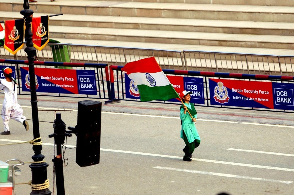smiled_young_indian_girl_walking_with_indian_flag