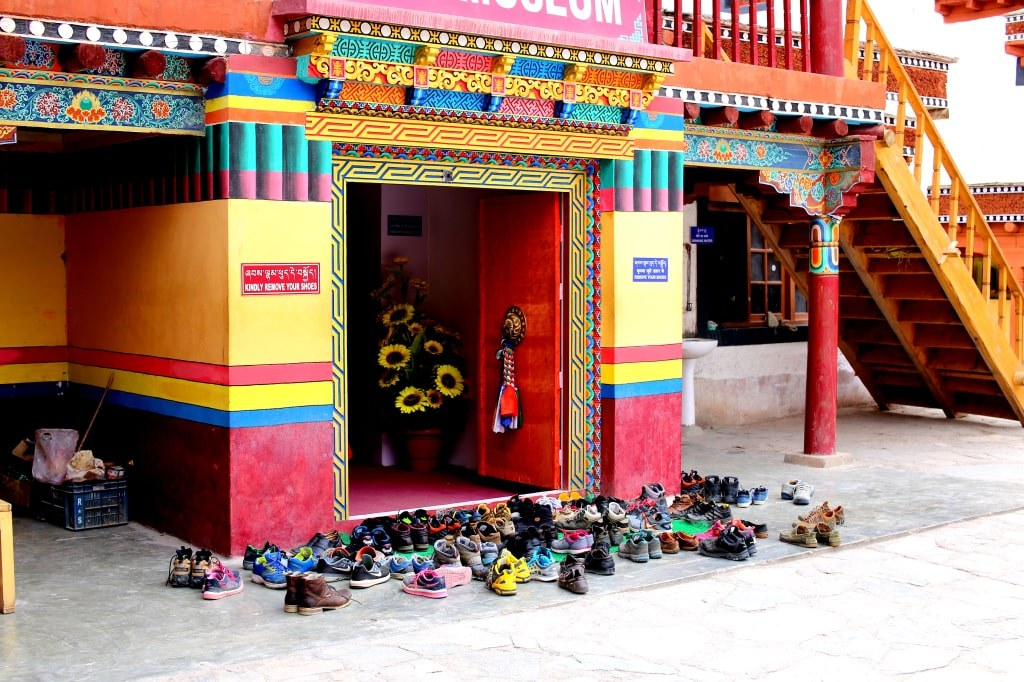 tens_paris_of_shoes_in_front_of_an_entrance_to_a_monks_monastery