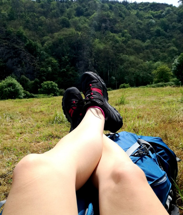 tired_legs_laying_on_a_blue_backpack
