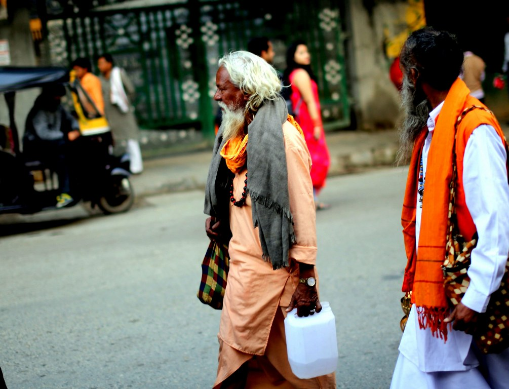 two_indian_men_walking_on_a_street_in_colorful_clothes