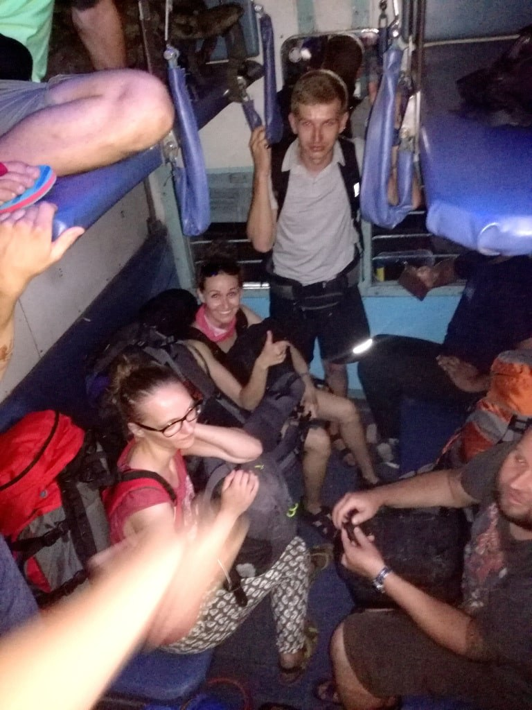 a_group_of_tourists_traveling_by_a_train_in_india