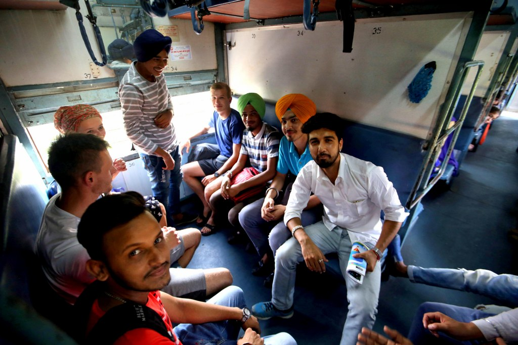 indian_and_polish_people_traveling_together_by_a_train
