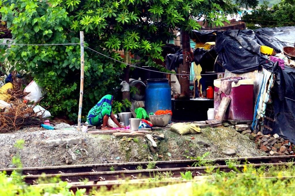 indian_woman_doing_washing_near_a_train_railway