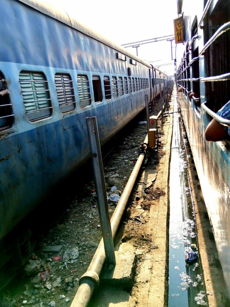 two_long_trains_in_an_indian_train_station