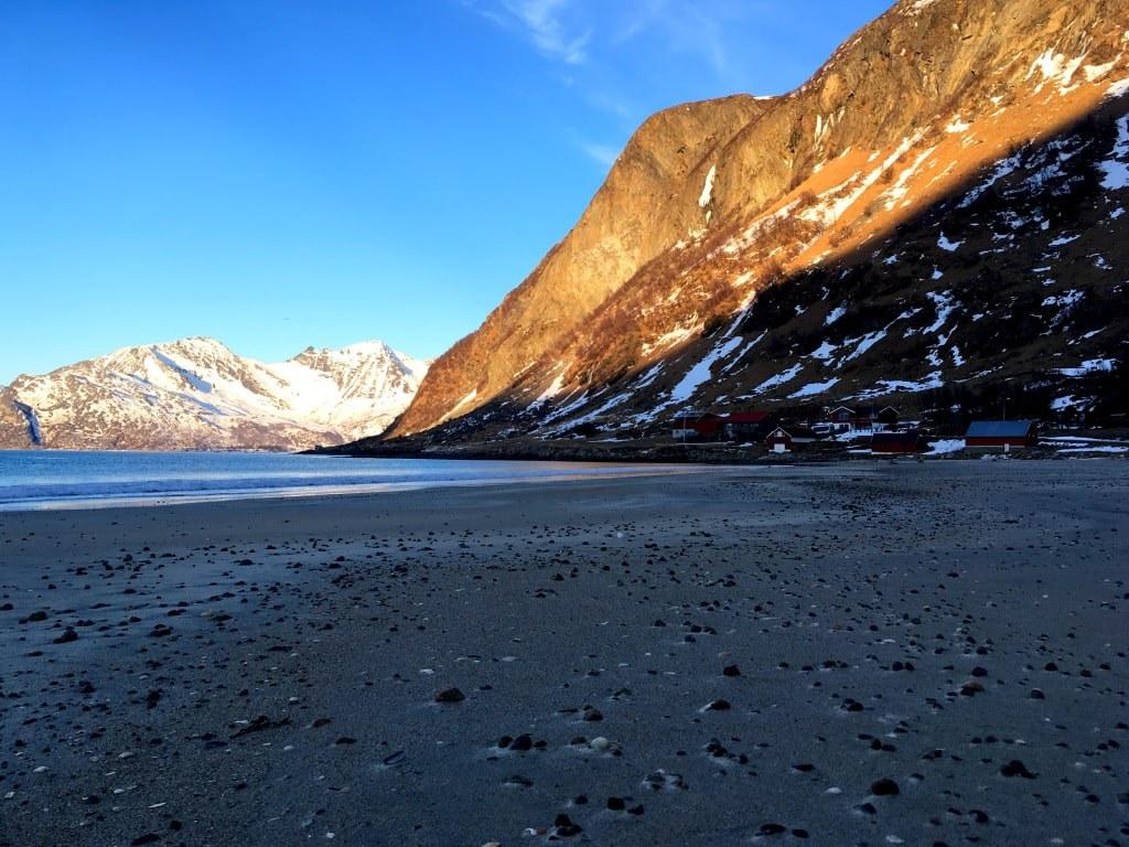 a_dark_sand_beach_in_norway