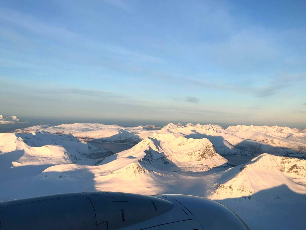 a_plane_view_to_a_snow_covered_mountains