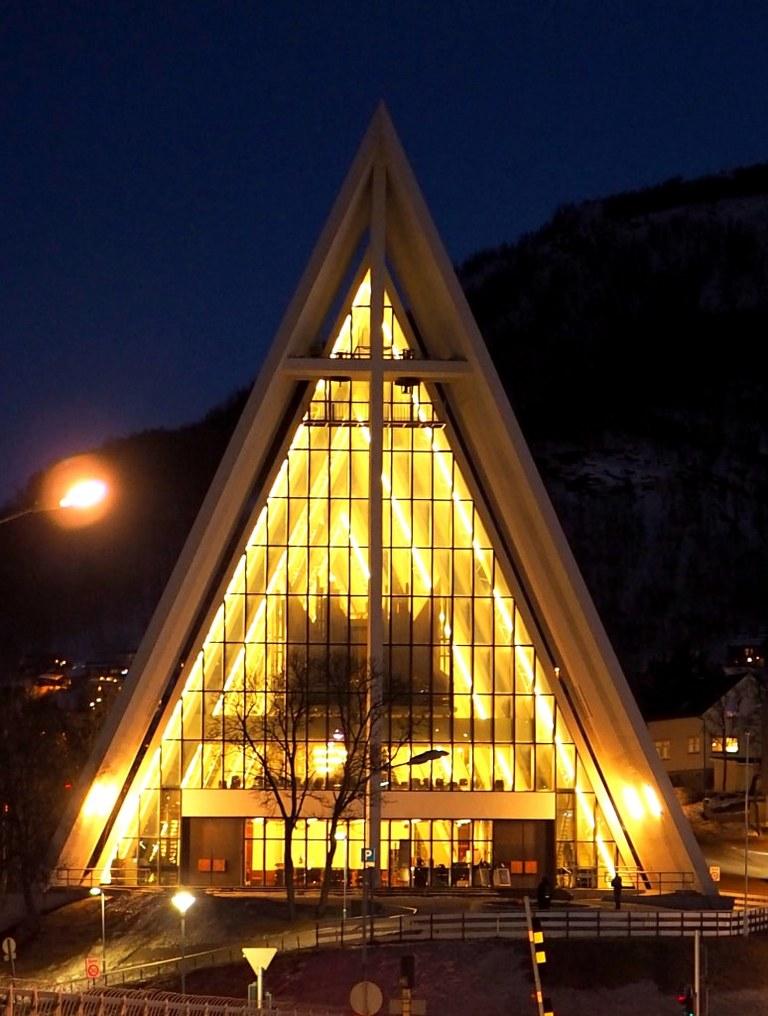 a_triangular_shaped_norwegian_church_under_a_light