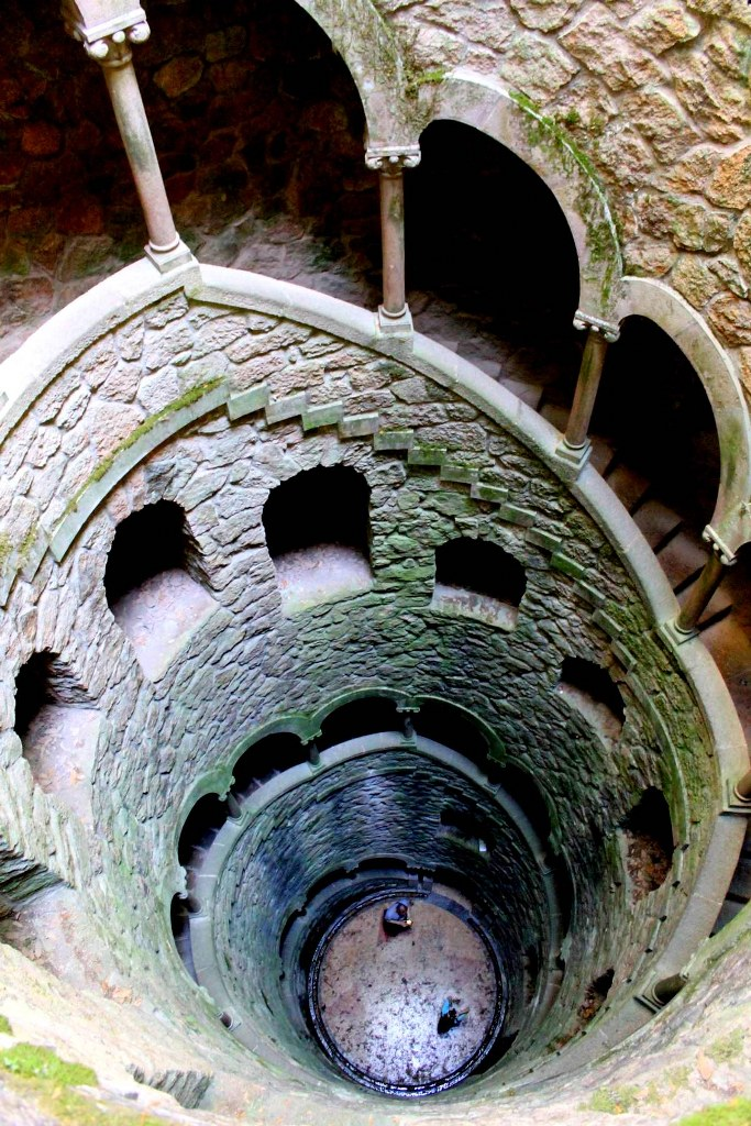 a_staircase_in_a_deep_well_in_sintra