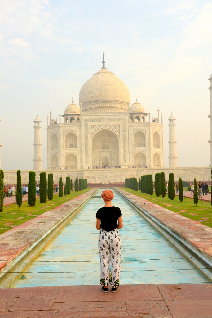 a_gril_standing_in_front_of_taj_mahal_in_agra