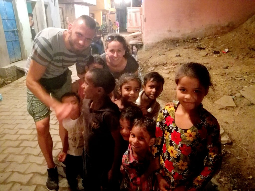 a_white_couple_surrounded_by_indian_children
