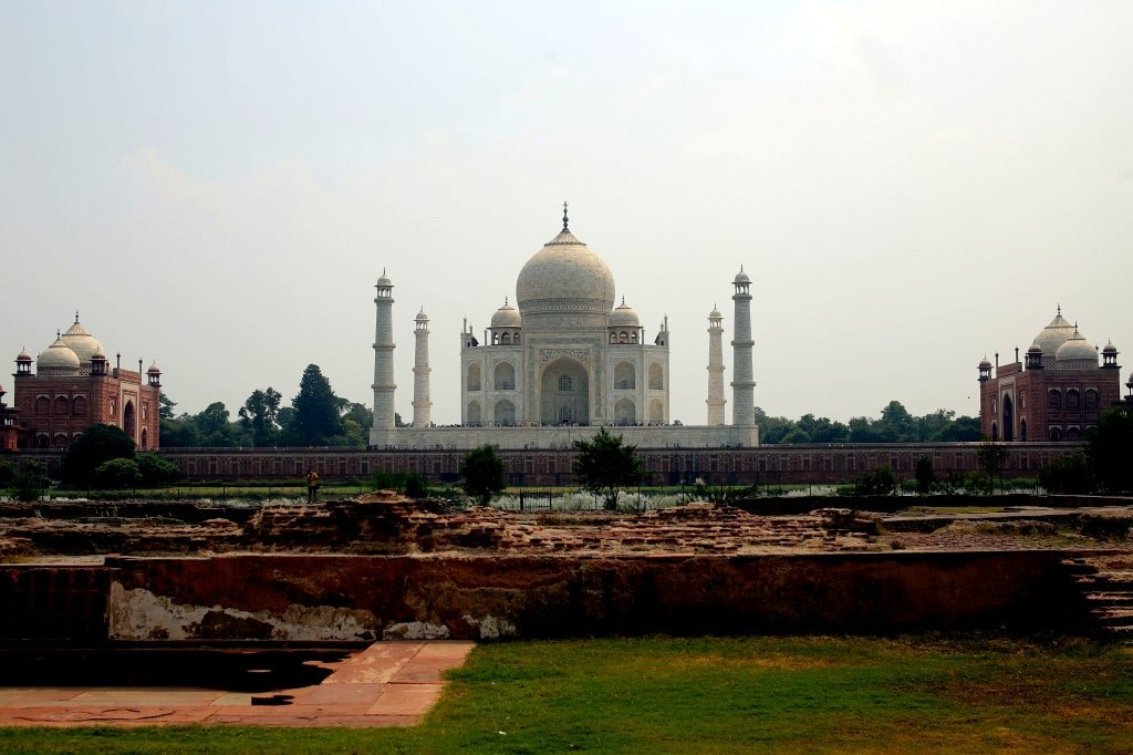 taj_mahal_viewed_from_a_park_on_the_other_side_of_a_river