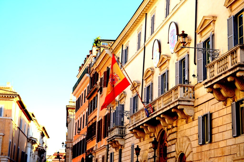 a_spanish_flag_waving_from_a_bulding