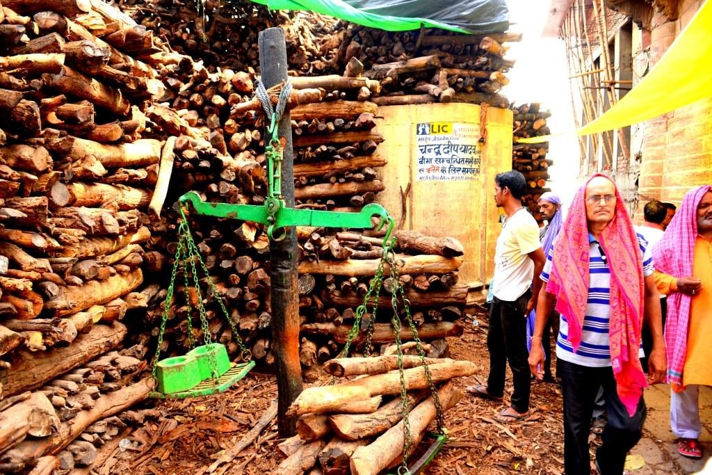 river_bank_in_varanasi_with_huge_piles_of_wood_ready_to_bury_deceased