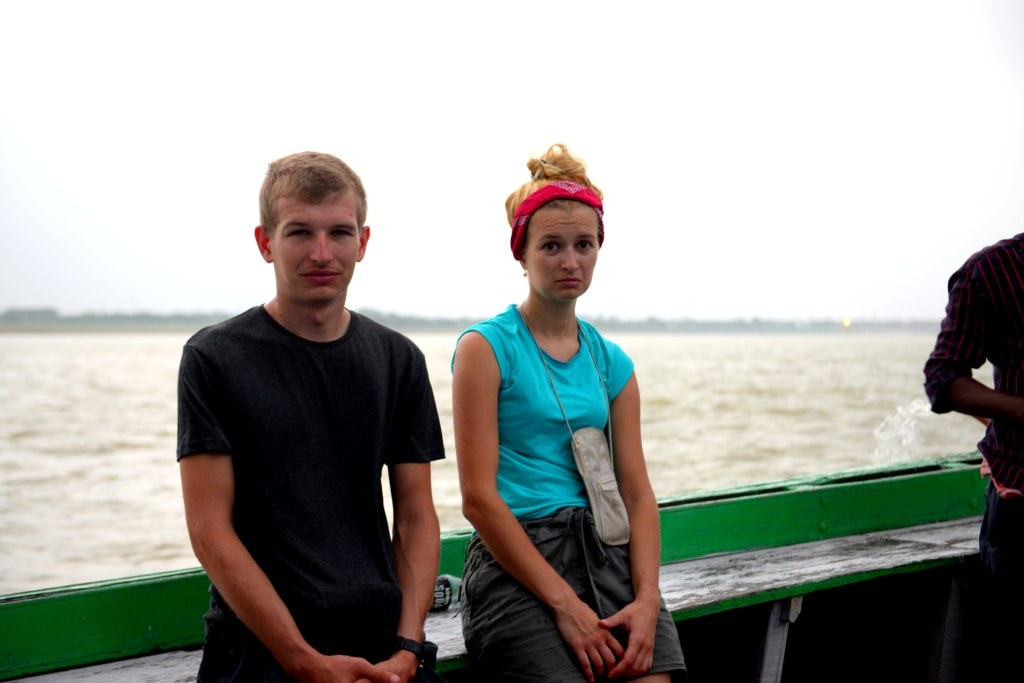 two_young_people_shaking_from_coldness_while_travelling_on_a_boat