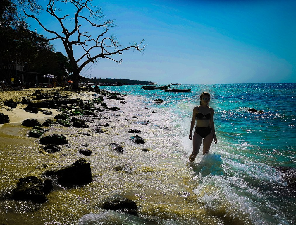 a_girl_standing_in_a_water_of_carribean_sea