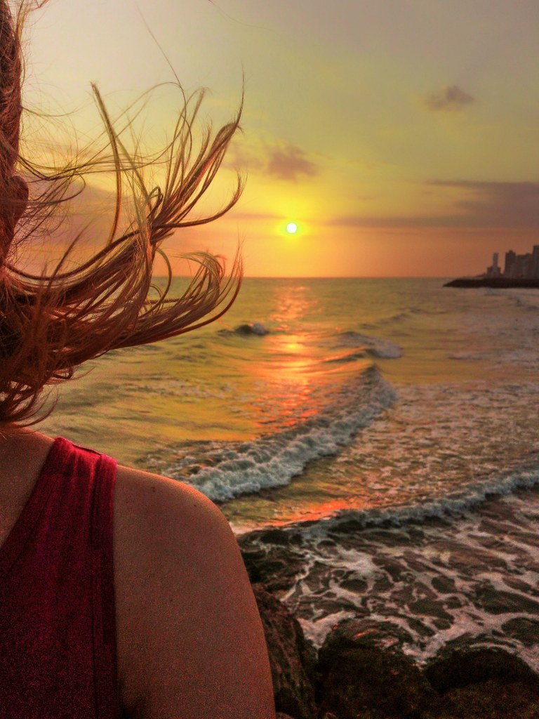 blonde_hair_waving_on_a_wind_in_sunset_light