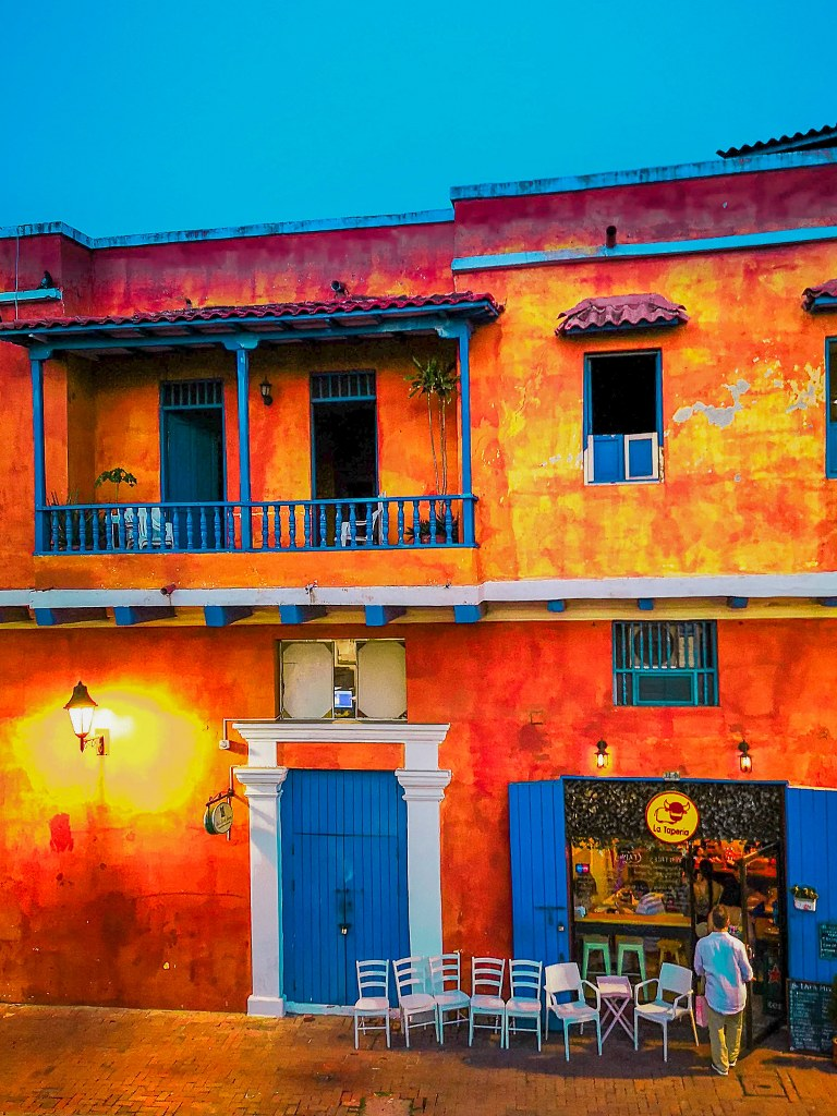 orange+painted_bulding_with_blue_doors_and_windows