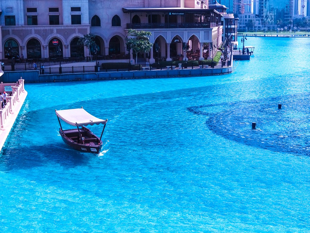 a_boat_sailing_around_the_burj_khalifa