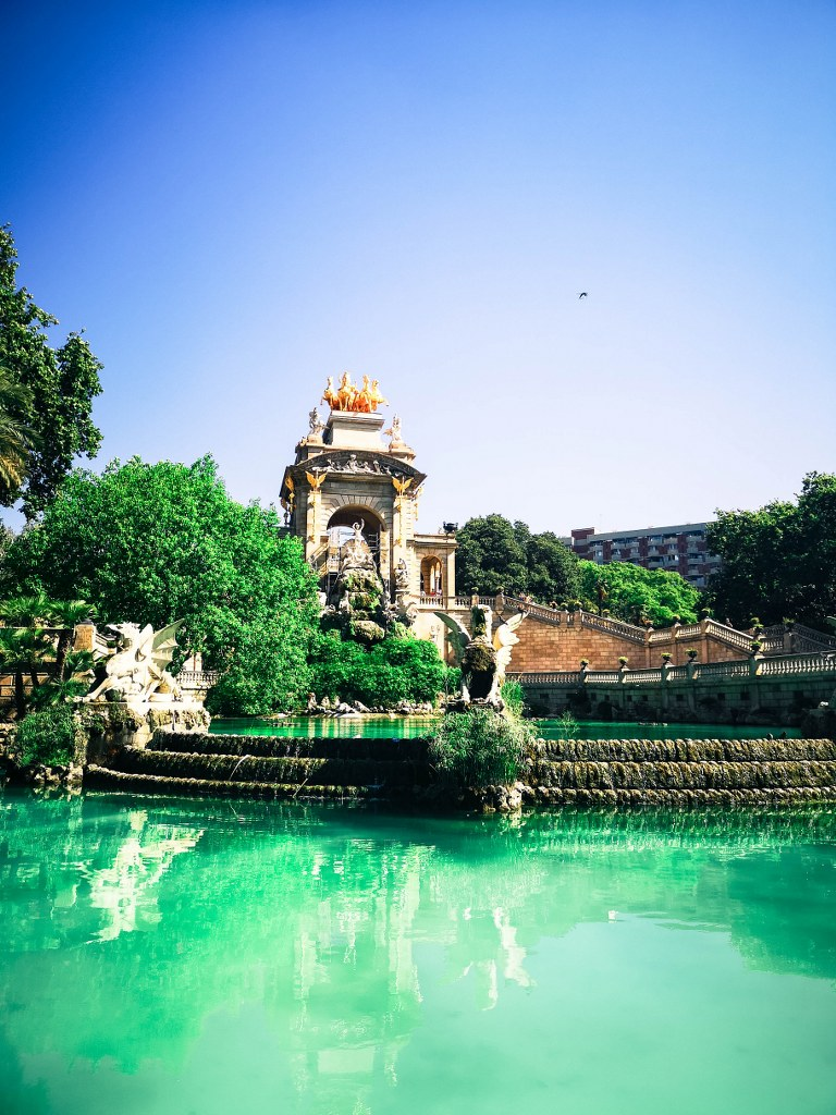 a_fountain_with_blue_water_in_barcelona_park