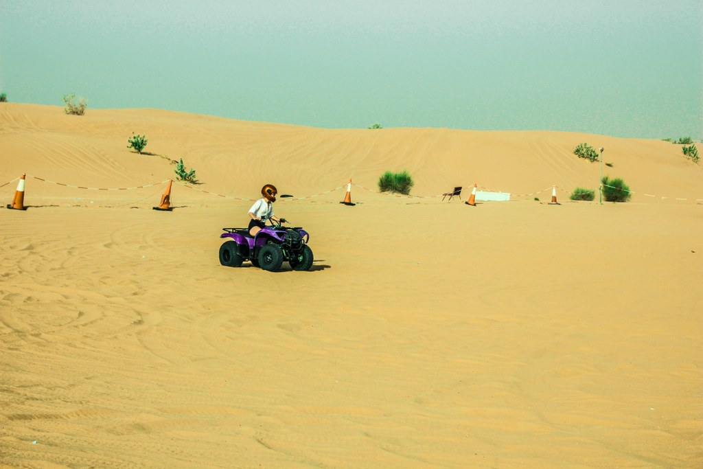 a_gilr_driving_quad_on_a_desert