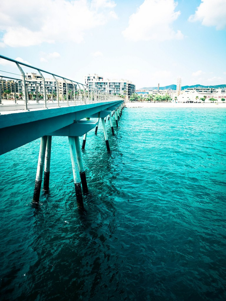 long_pier_surrounded_by_blue_clear_water