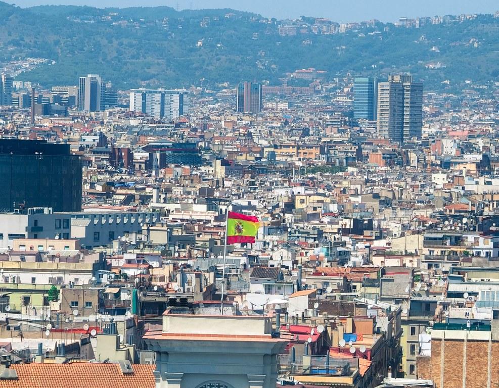 panorama_of_barcelona_with_waving_spanish_flag