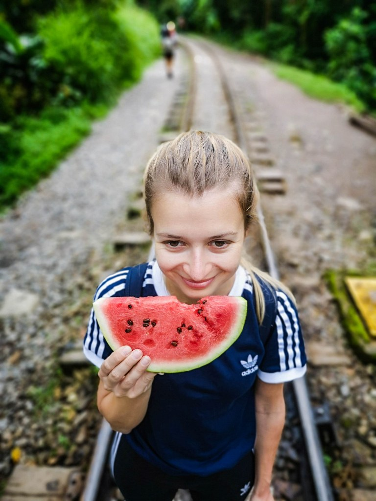 a_blonde_girl_eating_watermelon
