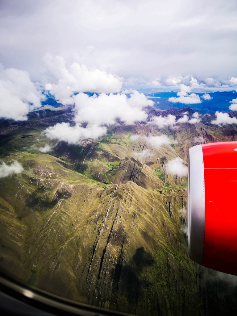 a_view_from_a_plane_of_andean_peaks