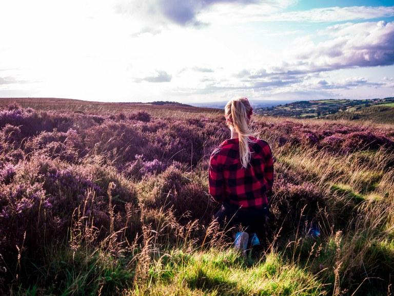 blonde_girl_taking_photos_in_purple_yorkshire_moors_national_park