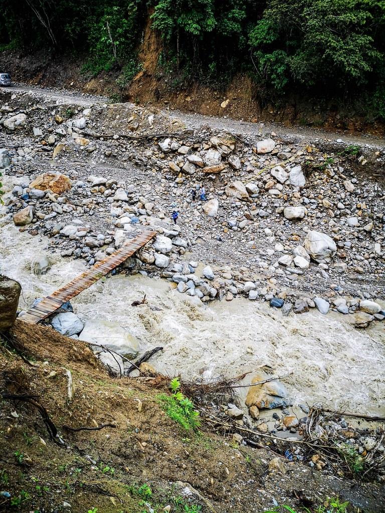 broken_vridge_on_a_mountain_river