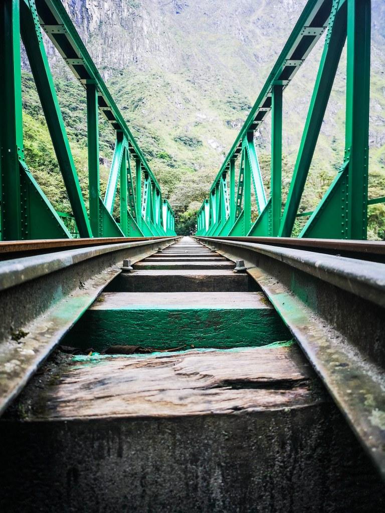 green_long_railbridge_crossing_andean_river