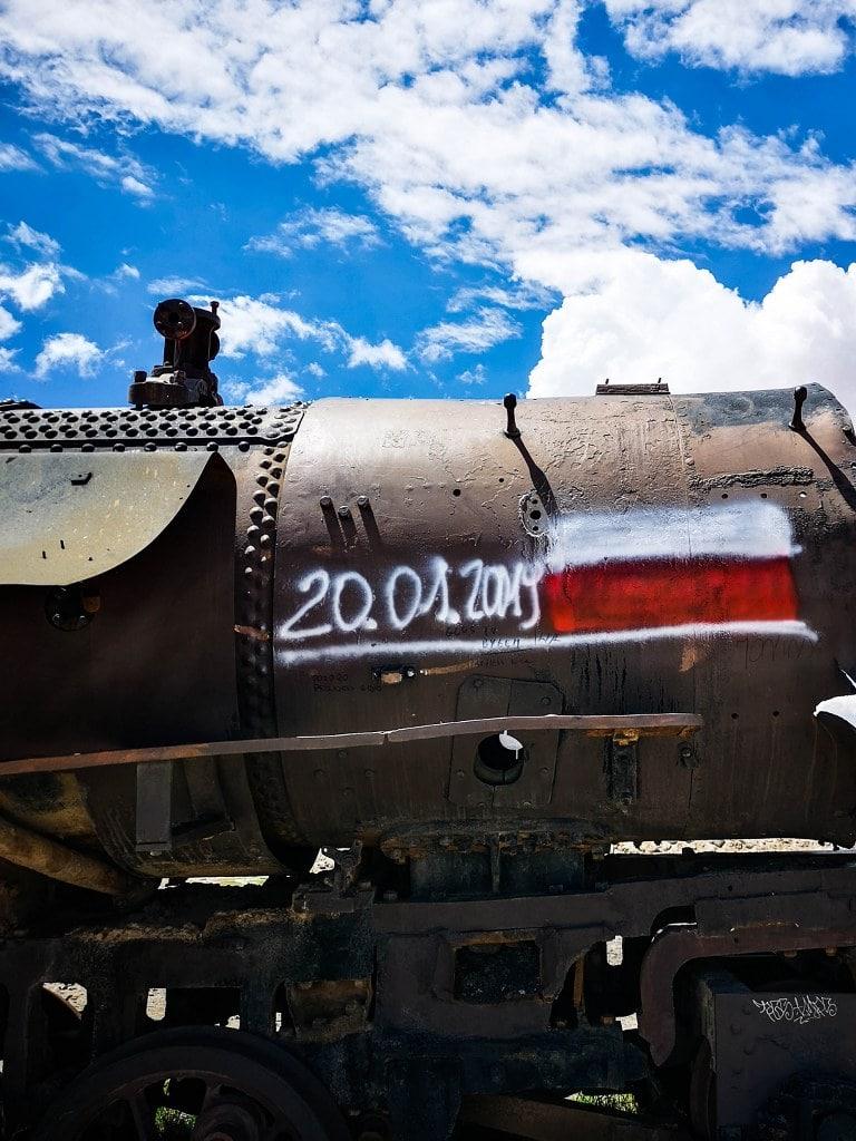 polish-flag-on-old-rusty-train