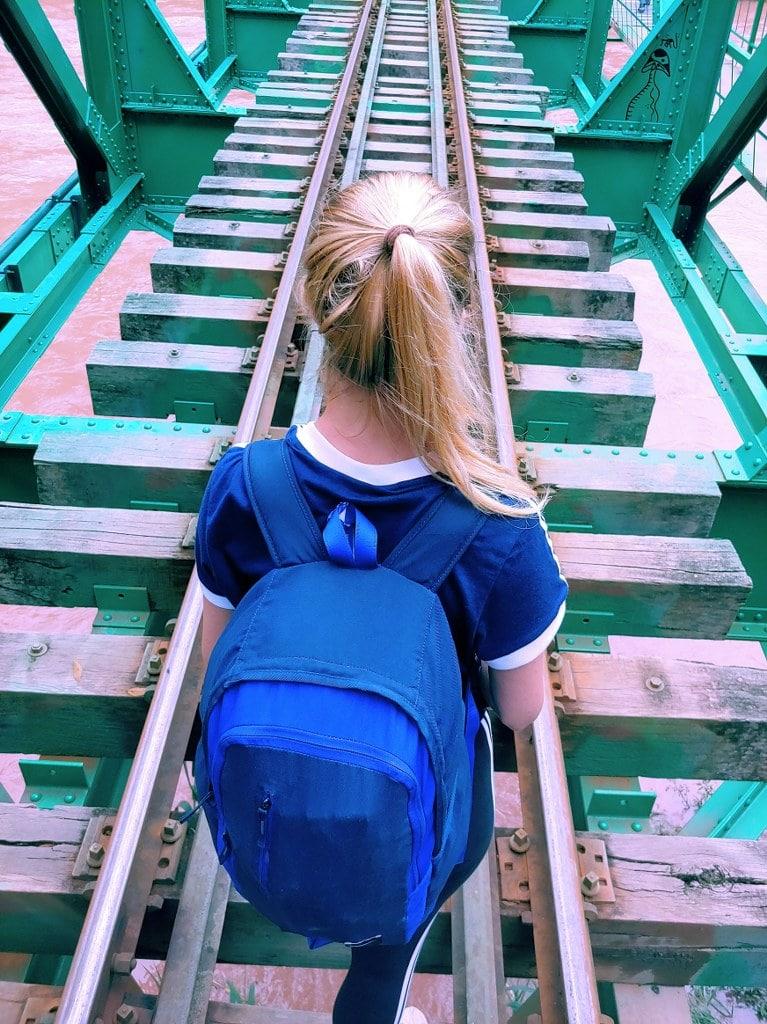 blonde-traveler-walking-to-machu-picchu-through-railways