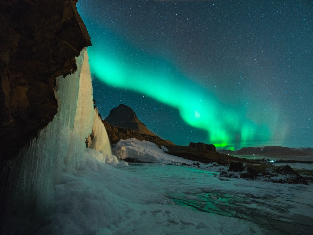 waterfall in the light of northern light