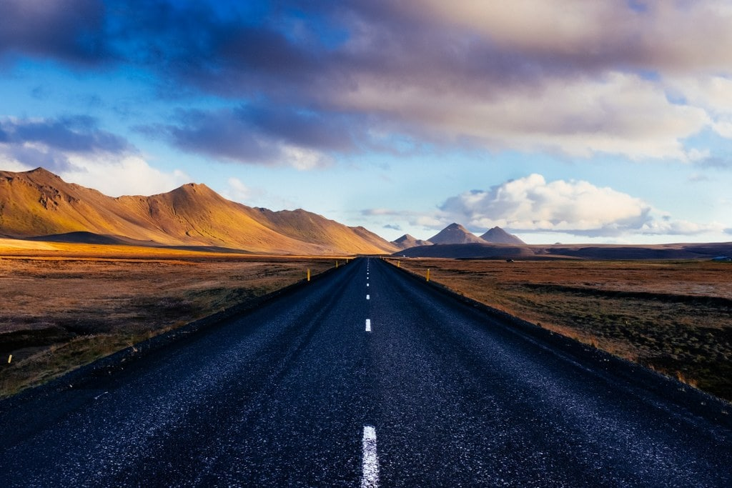 strait road in south america in a cloudy day