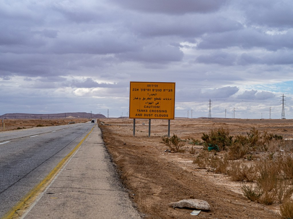 a_road_in_israel_with_yellow_warning_signs