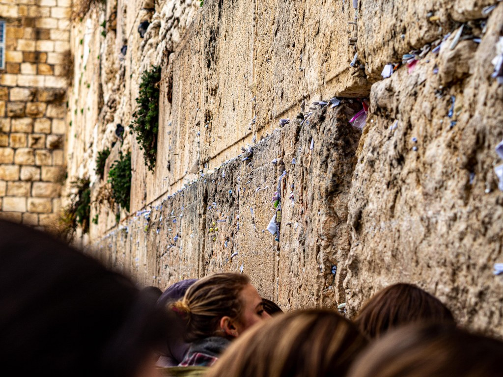 dozens_of_people_praying_in_front_of_the_western_wall