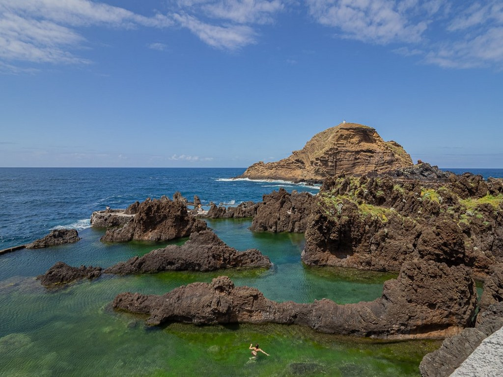 natural_volcanic_lava_pools_filled_with_green_oceanic_water