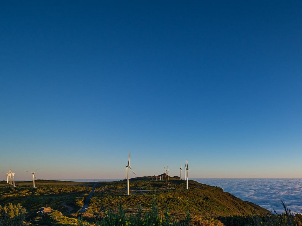 windmills_on_a_top_of_mountains_surrounded_by_clouds