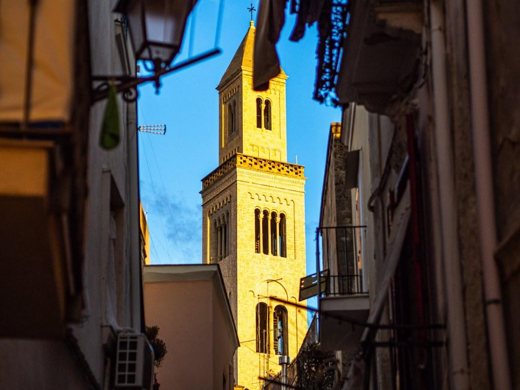 a_church_tower_in_bari_in_sunshine
